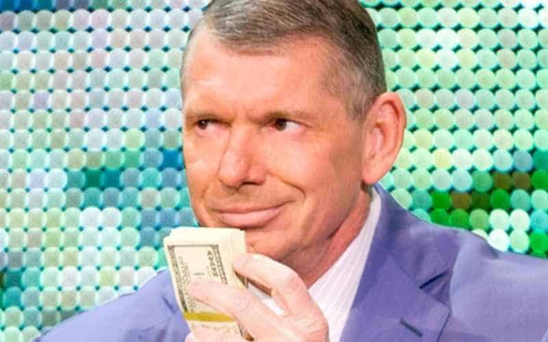Vince McMahon holding cash close to his face