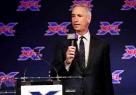 Oliver Luck speaking at an XFL press conference
